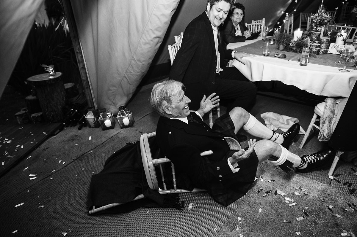 Grooms dad falling off his chair