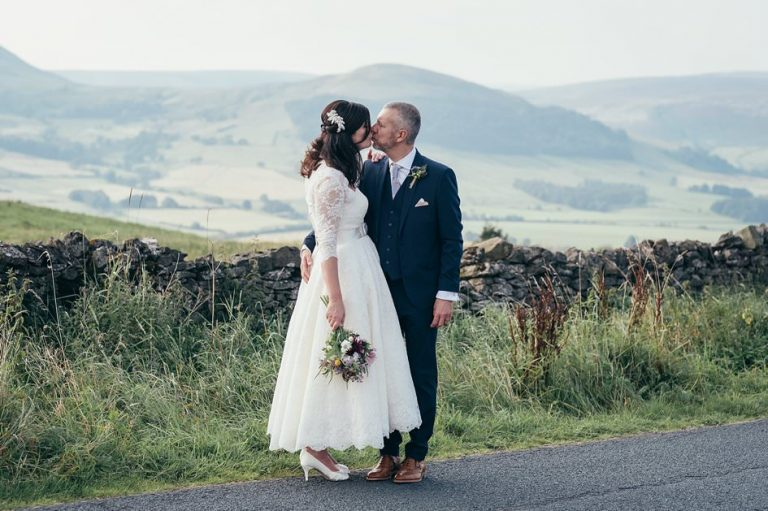 Newly weds kissing up in the hills at a wedding in the Forest of Bowland