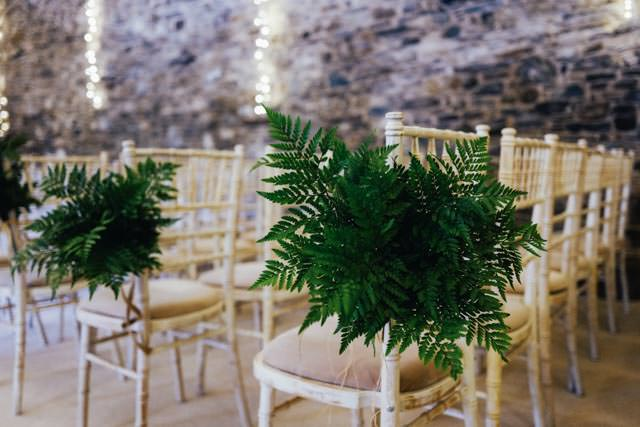 Chair decorated with simple ferns