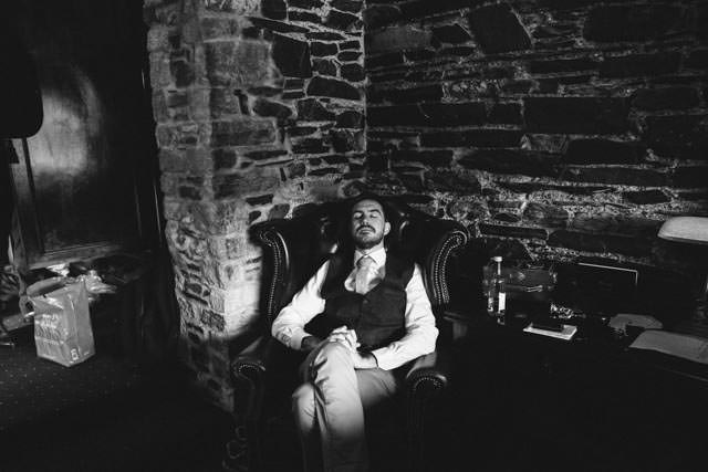 Groomsman asleep in the chair