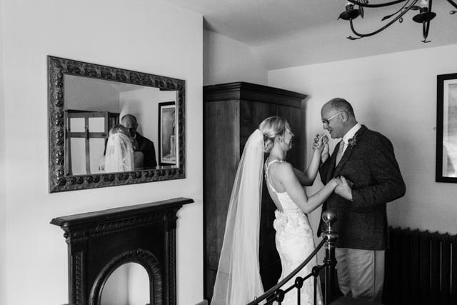 Bride and her father enjoying a moment before the ceremony
