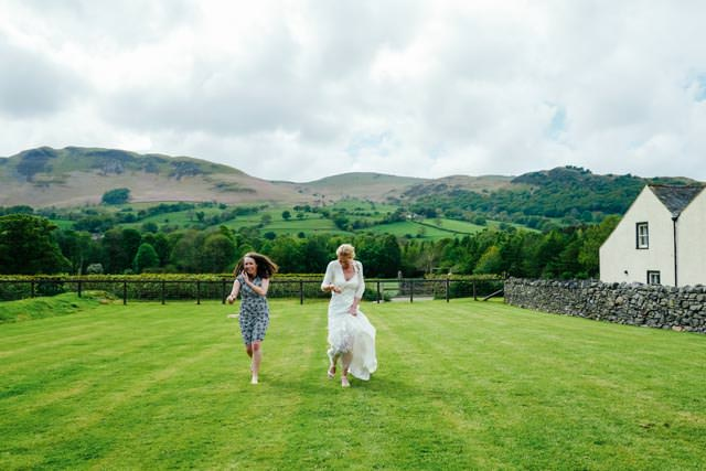 Bride and a guest having an egg and spoon race