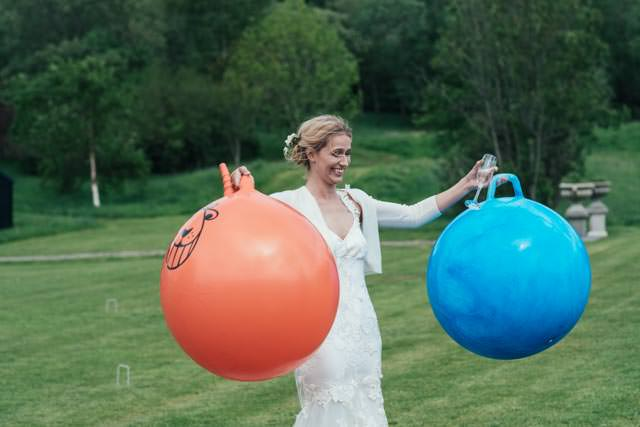 Bride holding two space hoppers