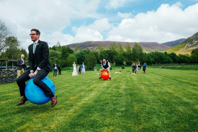 Groom and Brides dad racing on space hoppers