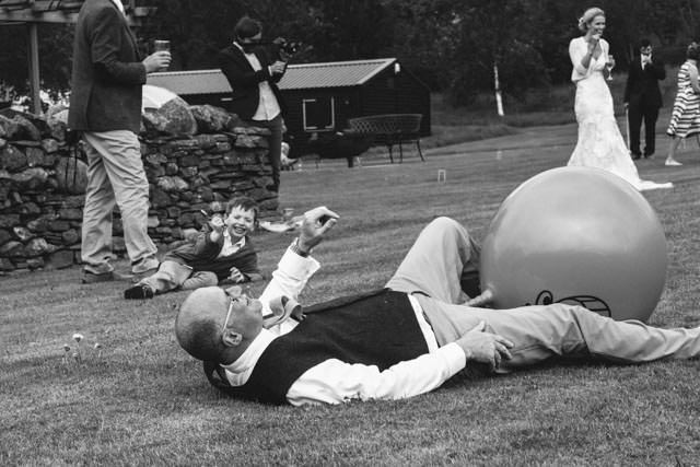 Brides dad falling off a space hopper whilst she laughs in the background