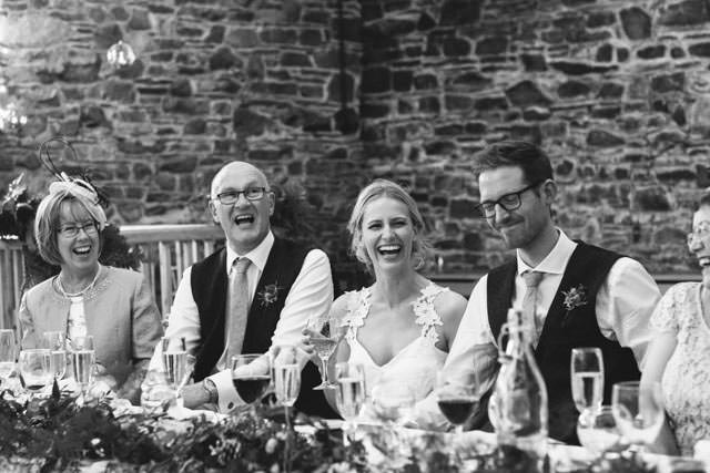 Wedding party laughing at the best mans speech