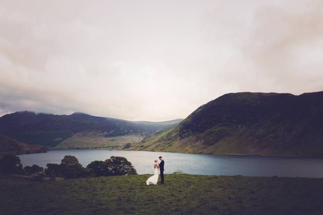 Bride and groom overlooking Buttermere lake