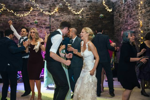 Bride and groom laughing and dancing