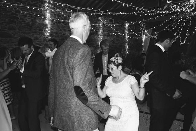 Grooms mum and dad dancing together