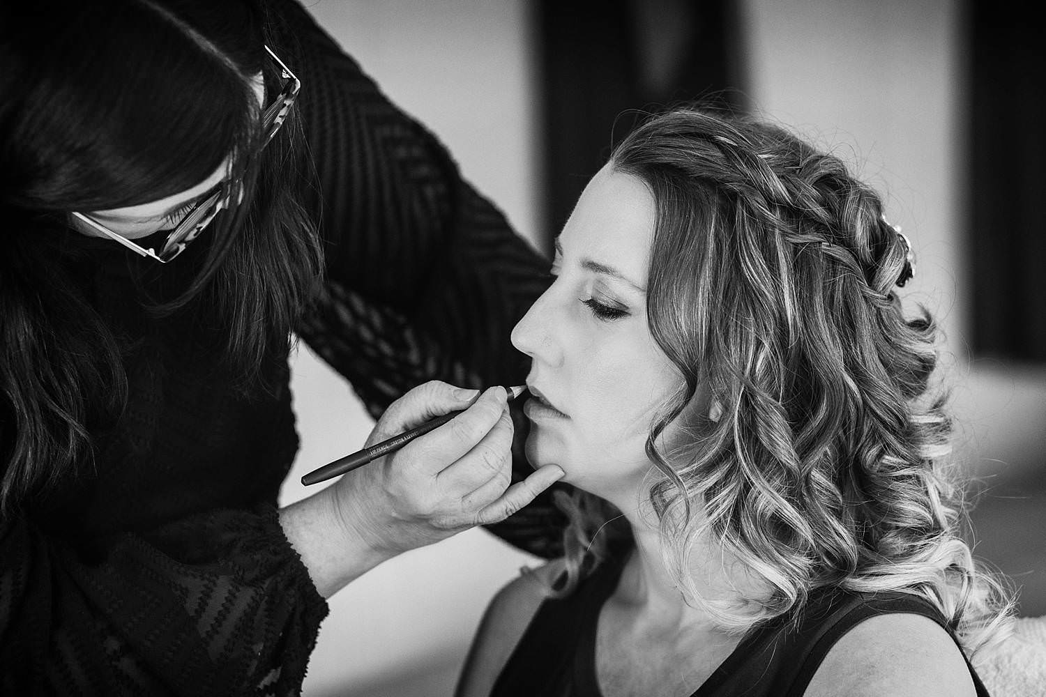 Bride having her wedding make up done by a make up artist