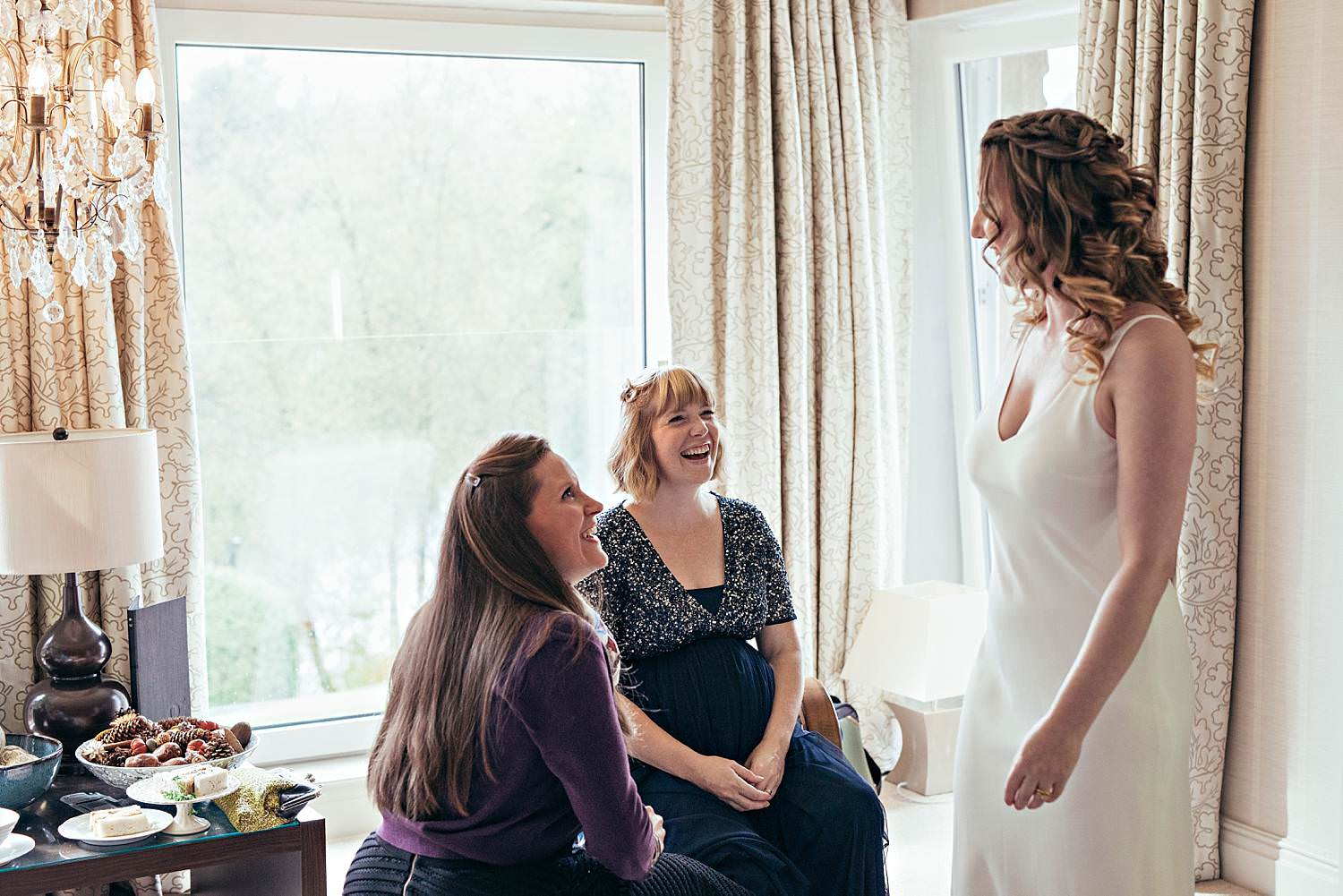 bride and her friends talking and laughing