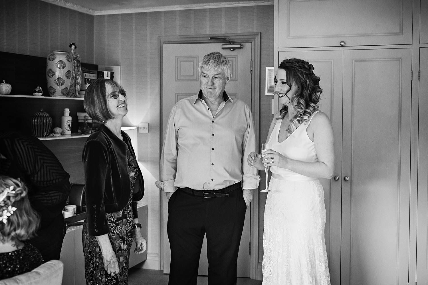 Bride's mum and dad seeing her in her wedding dress