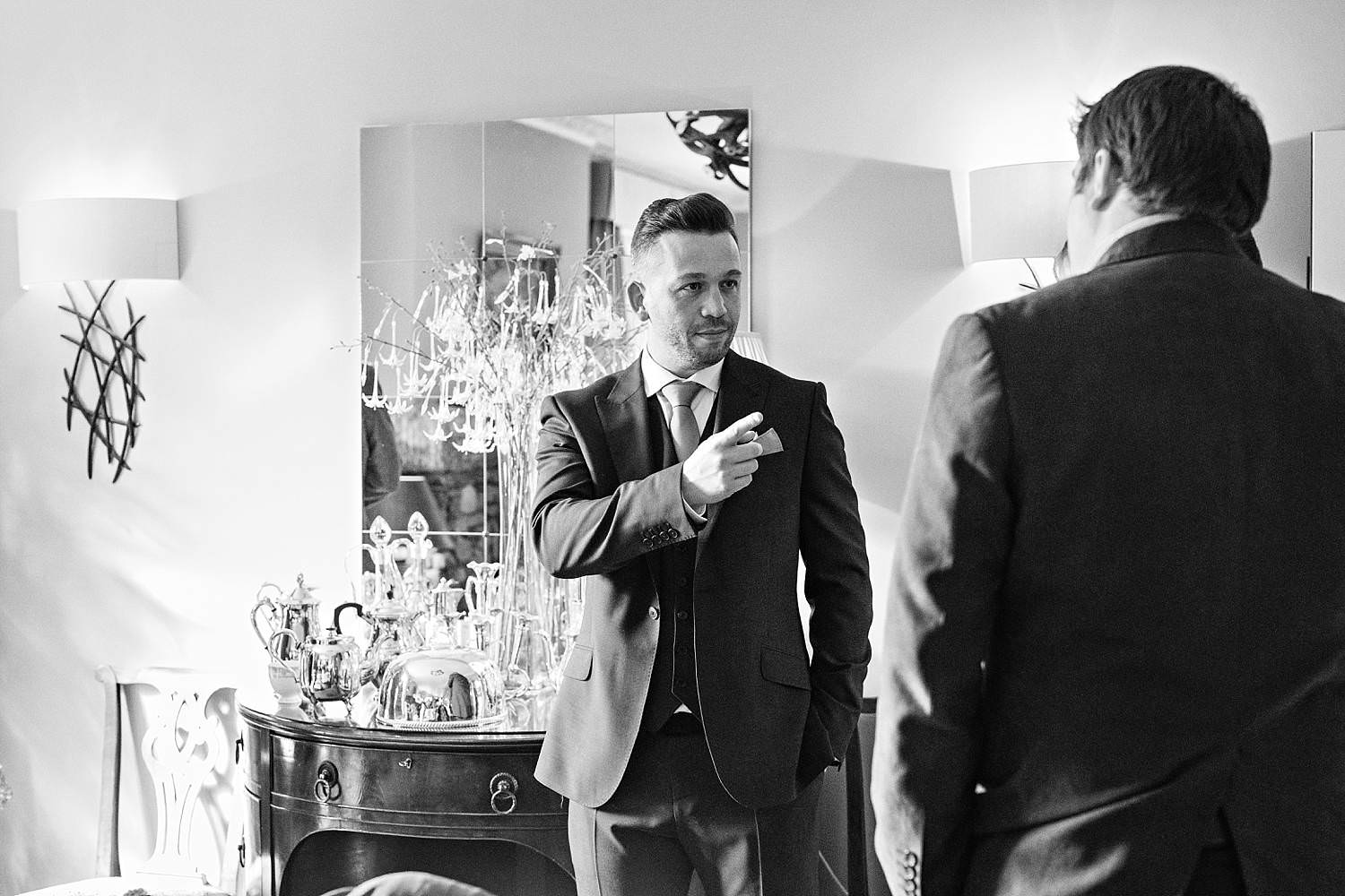Groom pointing at one of his guests