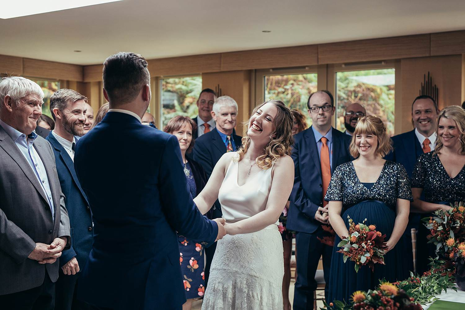 Gilpin Lake House civil ceremony. Bride and groom laughing