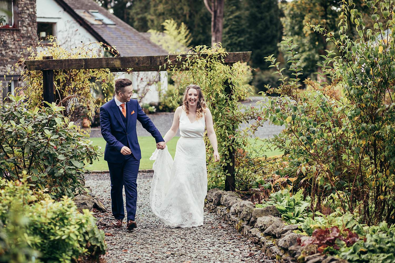Bride and groom in the gardens at Gilpin Lake House wedding photography