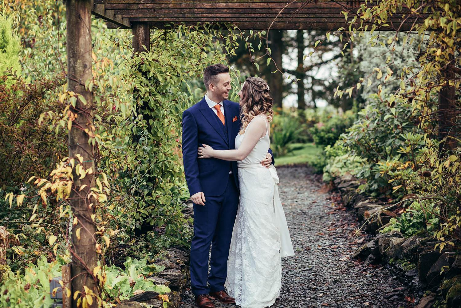 Bride and groom in the gardens at Gilpin Lake House