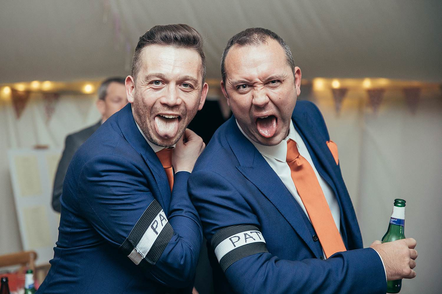 Groom and his friend doing a New Zealand Rugby pose