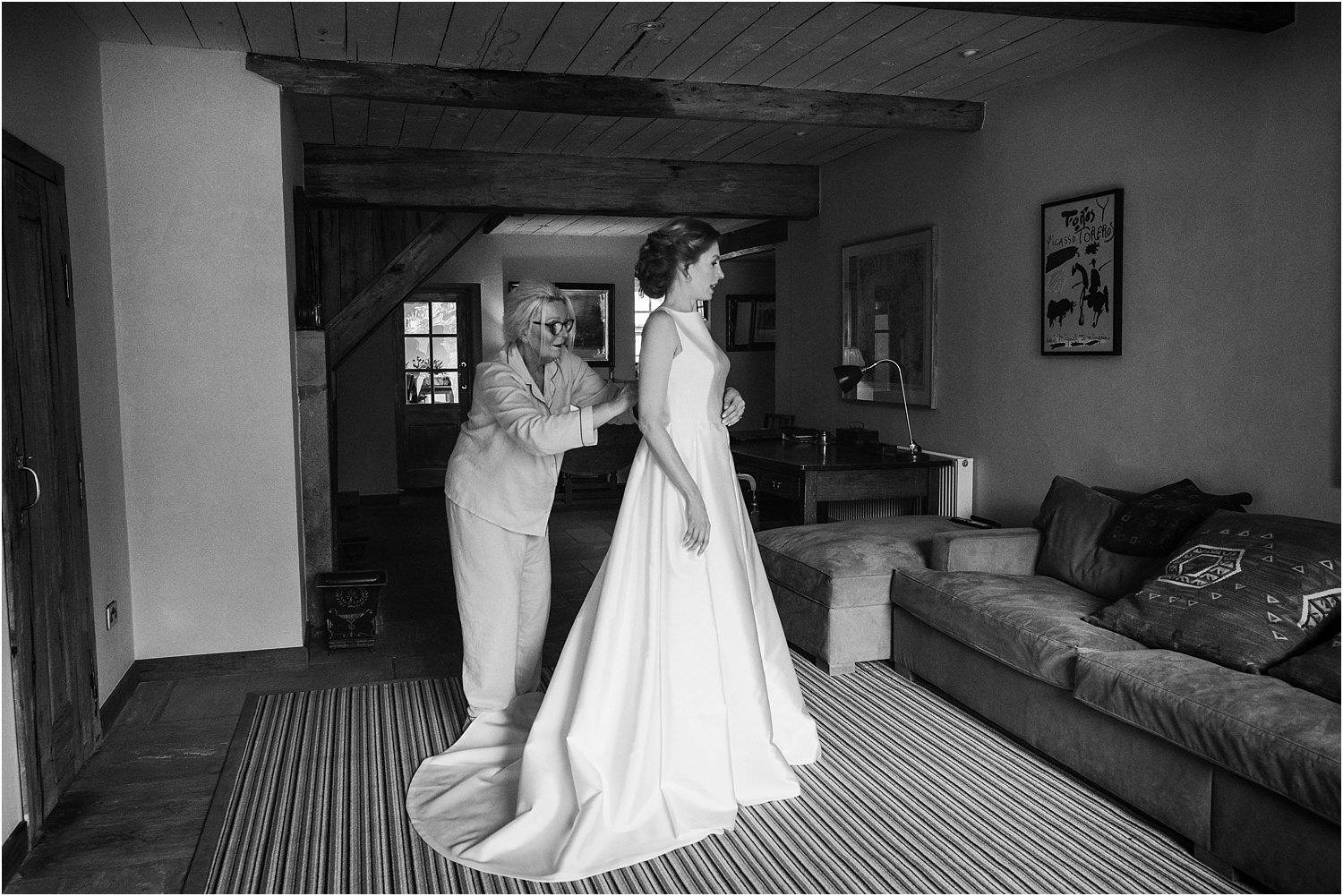 Bride helped into her dress at The Piggeries, part of The Inn at Whitewell