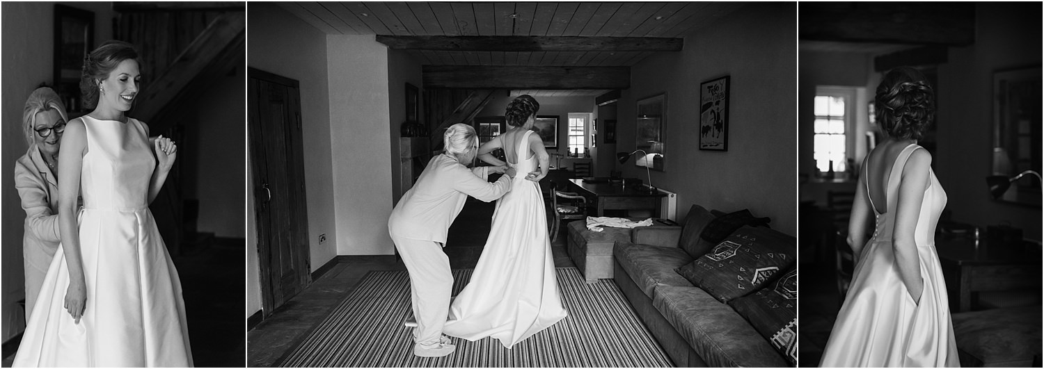 Bride being helped into her Jesus Peiro wedding dress at The Inn at Whitewell