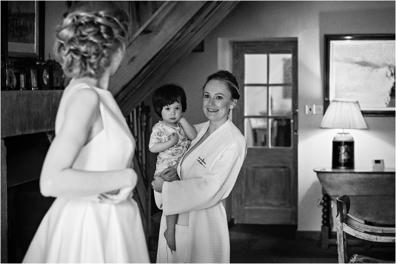 Bride and her bridesmaid and little girl prior to her weddingat Lancashire wedding venue, The Inn at Whitewell