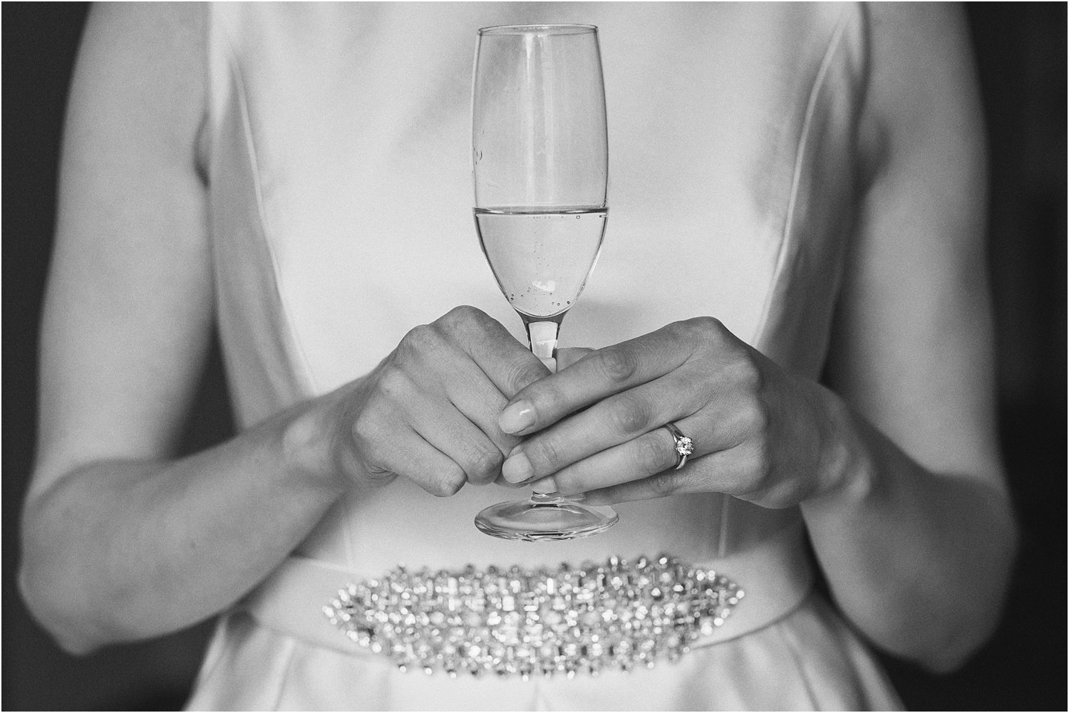 Bride with glass of champagne in hand before her wedding in the Trough of Bowland