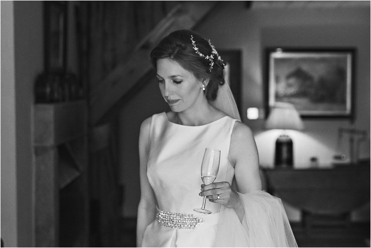 Bride with champagne at Lancashire wedding venue, The Inn at Whitewell.