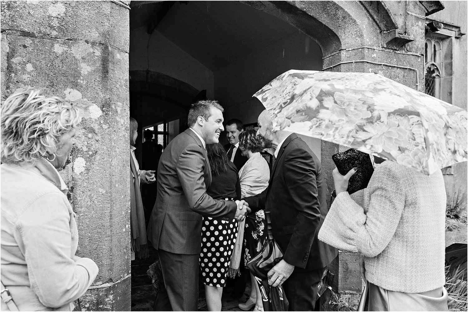Bridegroom greets his guest at the church door prior to his Lancashire wedding