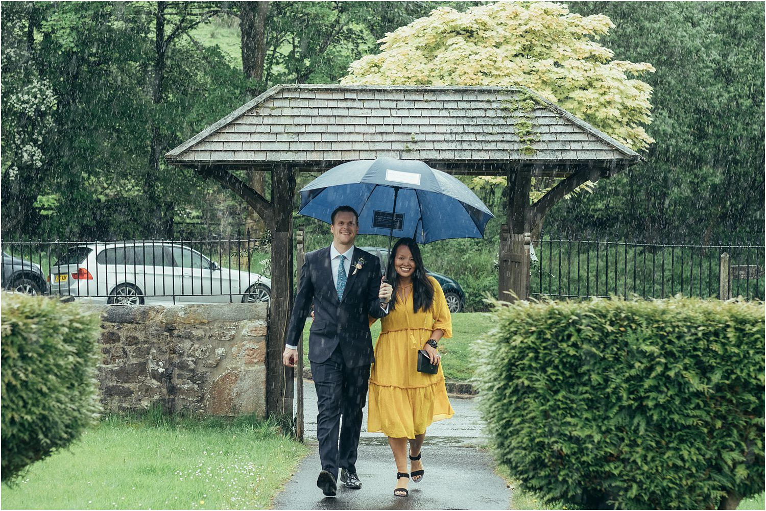 Guests arriving in the rain for Lancashire wedding
