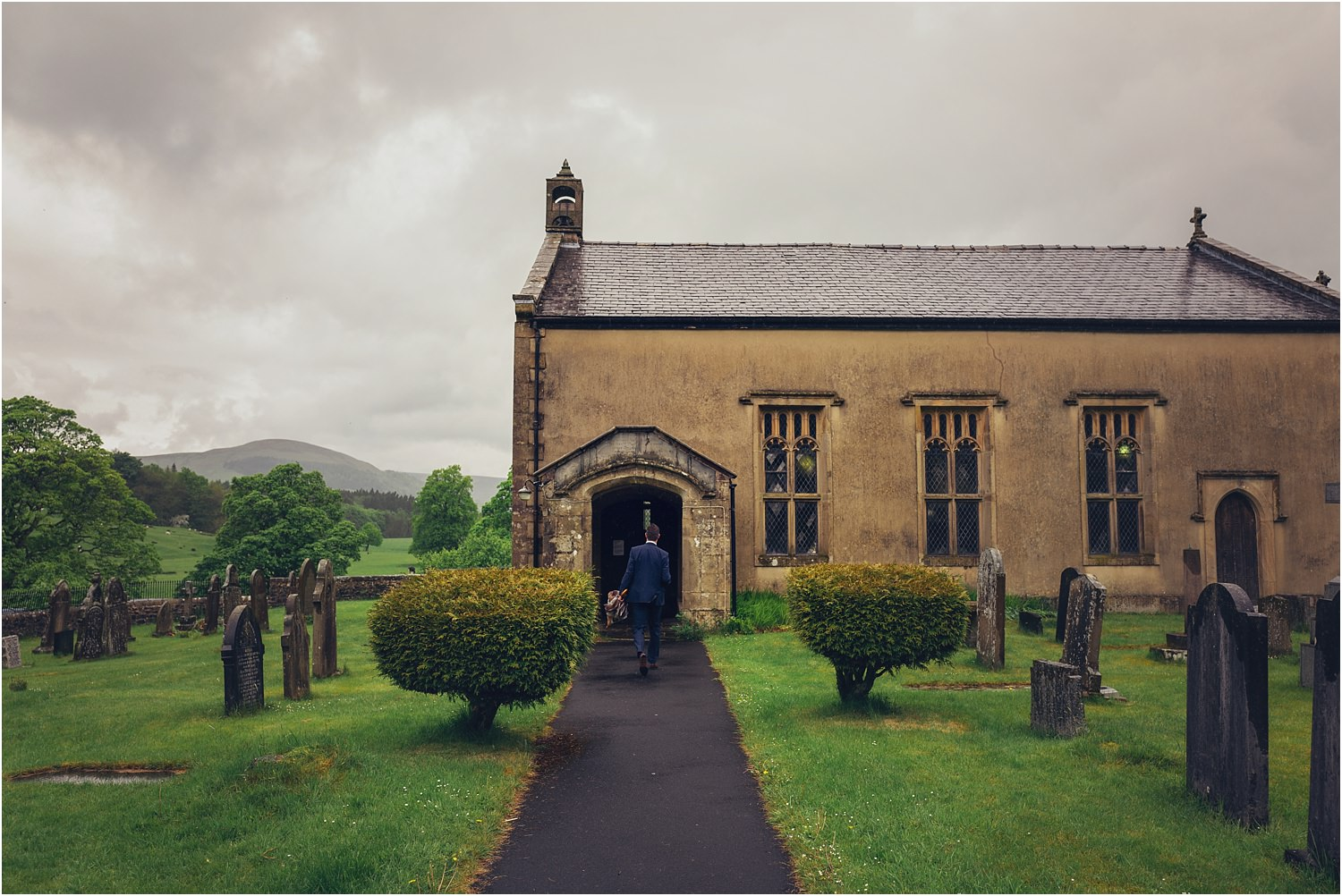 Lone guest walks up path to beautiful rural Lancashire church