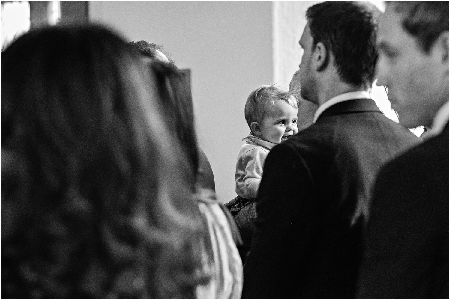 Baby in the congregation at Lancashire wedding