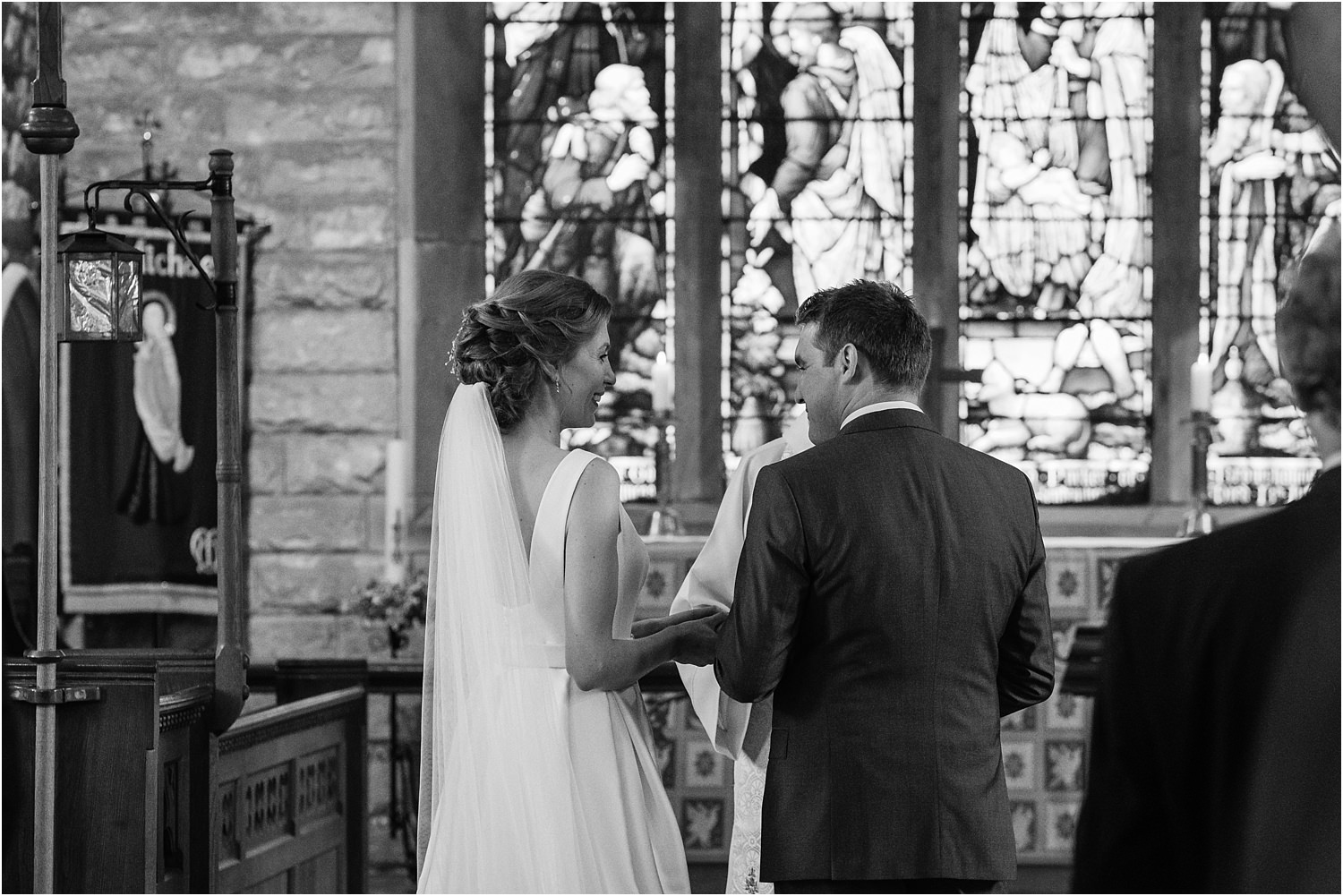 Bride and groom exchange vows at the altar of rural Lancashire church