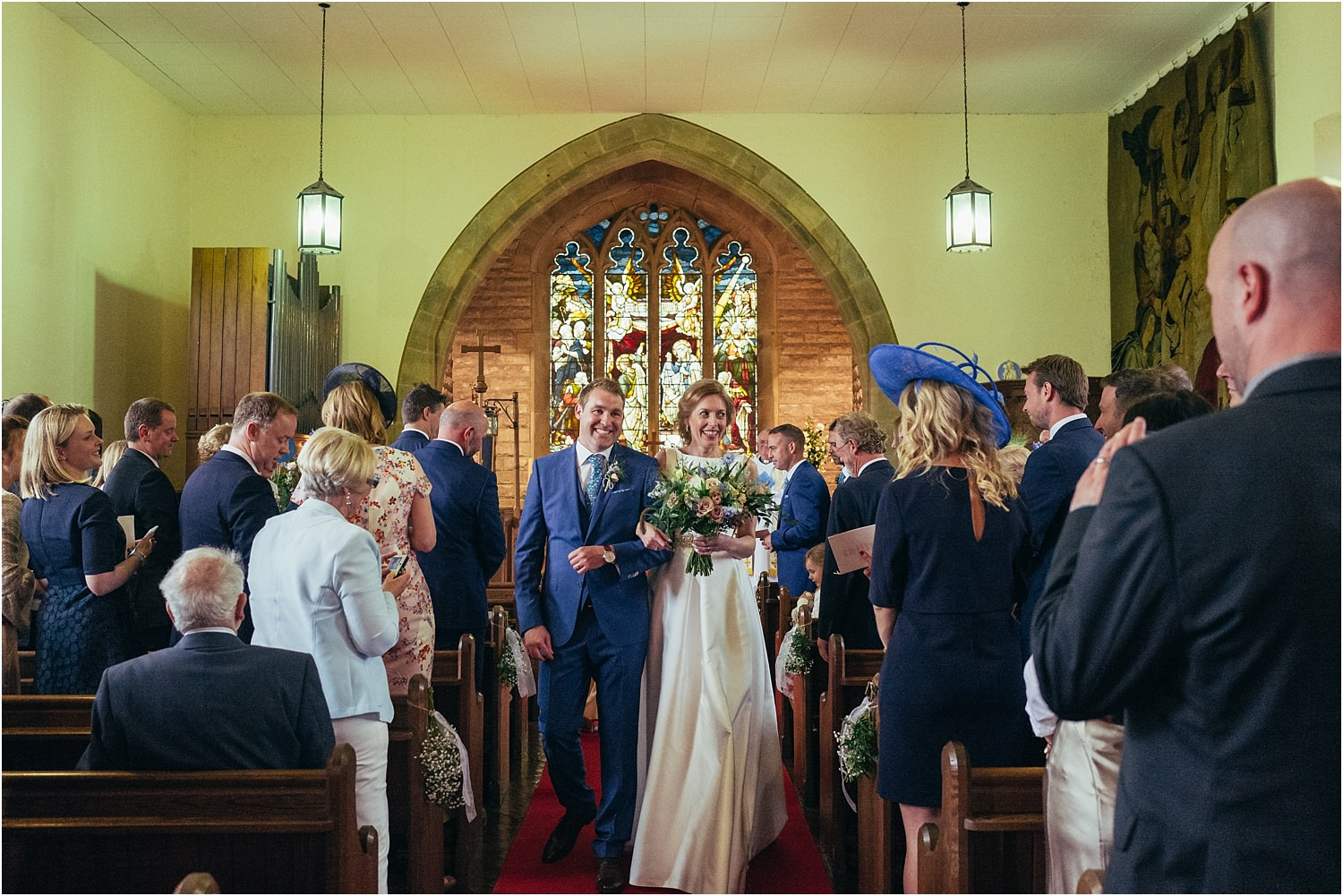 Bride and groom enjoying the walk down the aisle after their Lancashire wedding