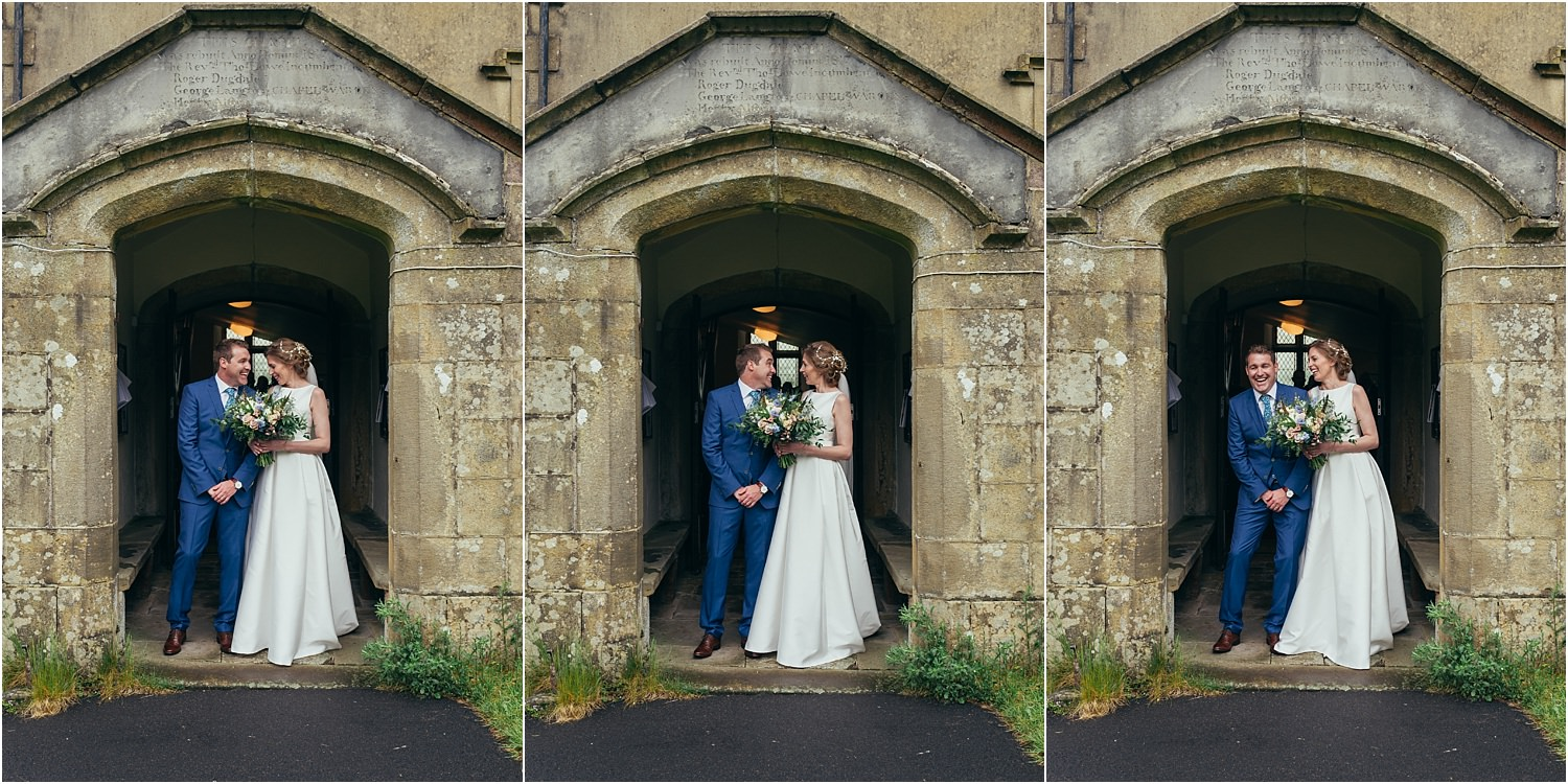 Bride and groom at the church door after their wedding ceremony in rural Lancashire church