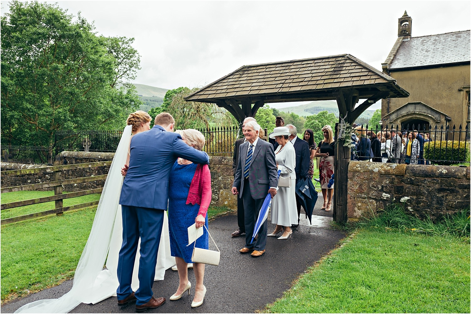 Bride and groom and their guests leave Lancashire church after the wedding ceremony