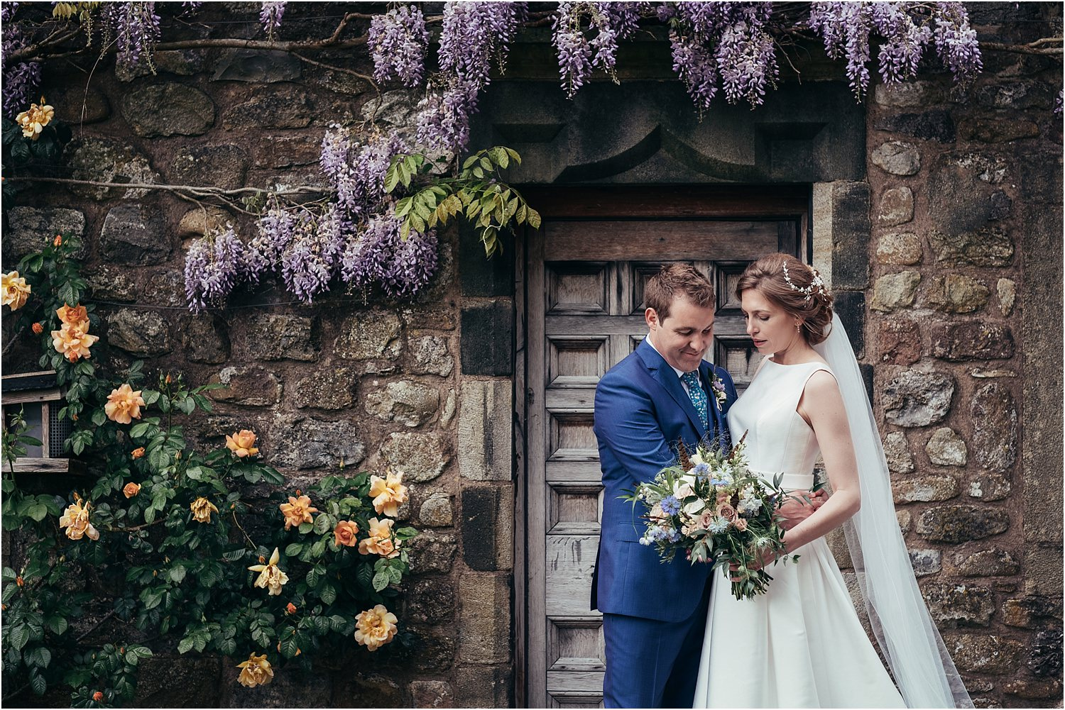 Bride, in Jesus Peiro dress and groom outside the front of the Inn at Whitewell in Lancashire