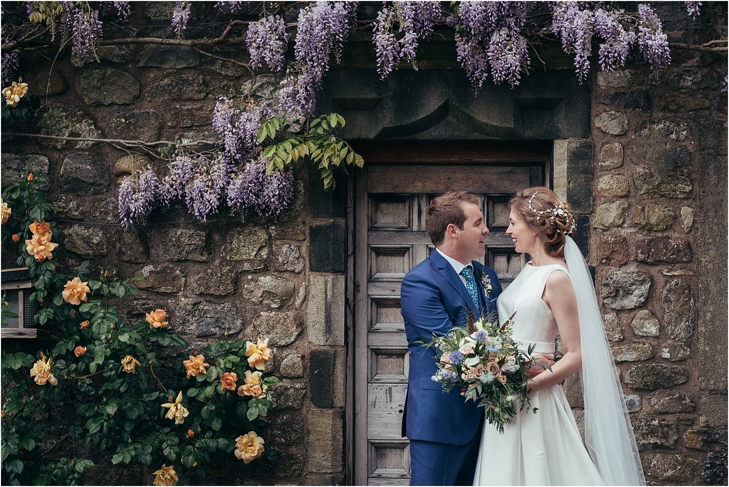 Lancashire bride and groom with bridal bouquet by The Flower Shop of Clitheroe