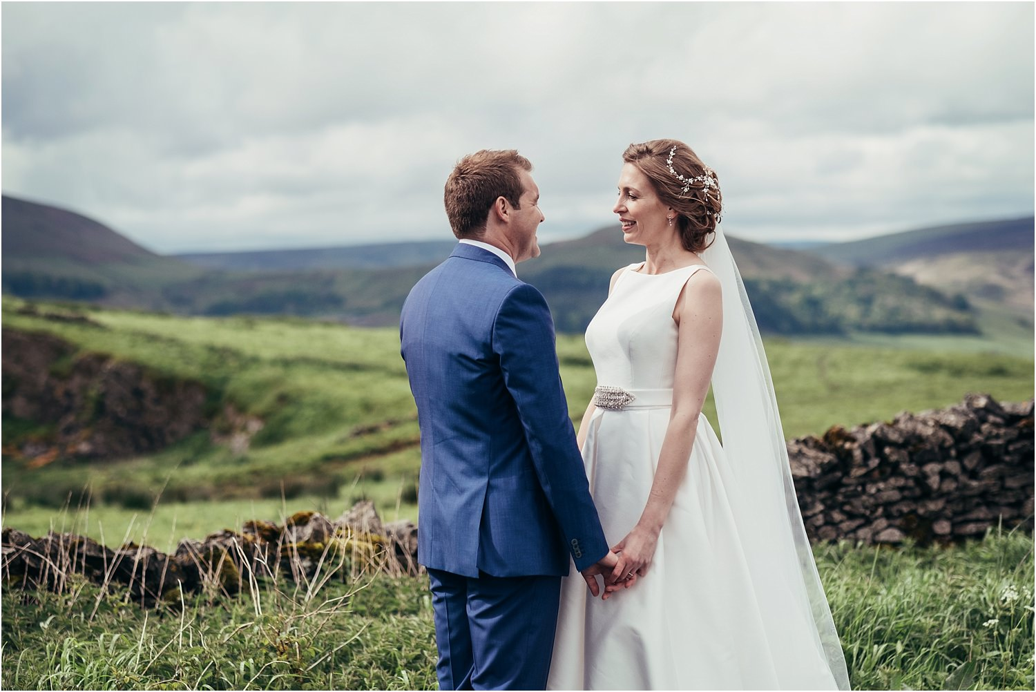 Bride and groom with Trough of Bowland in the background at their rural Lancashire wedding