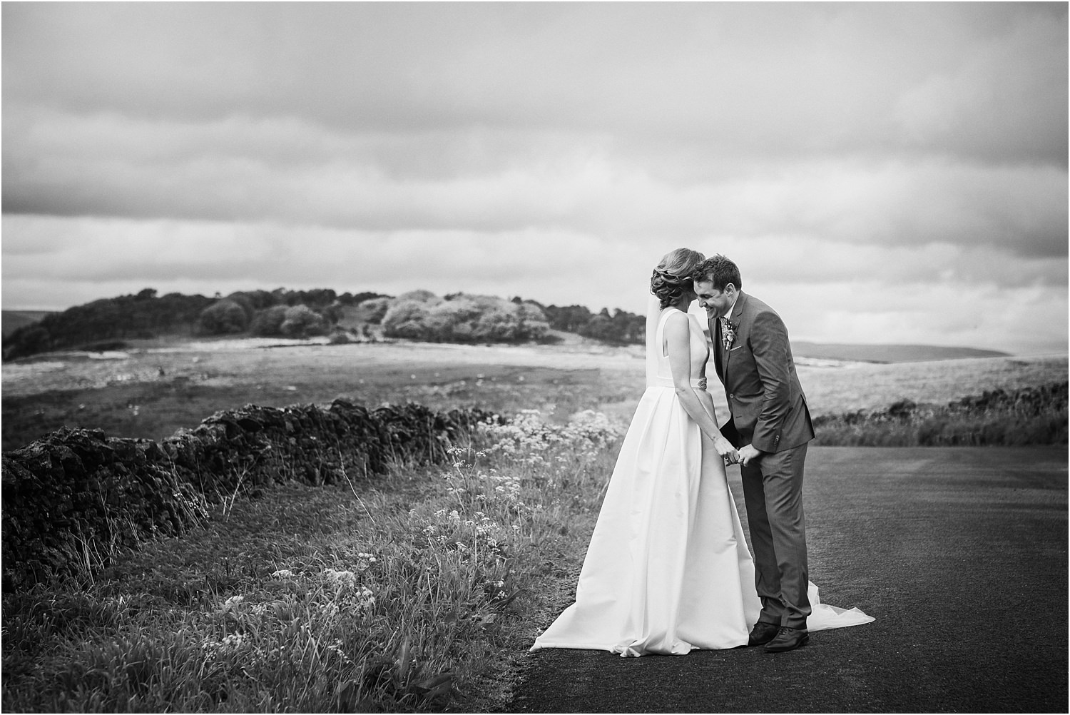 Bride whispers in groom's ear after their Lancashire wedding