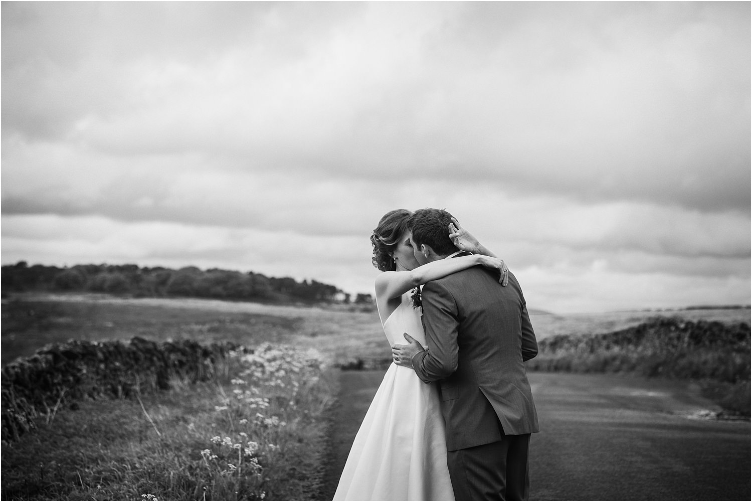 A passionate embrace for bride and groom after their wedding in the Trough of Bowland, Lancashire