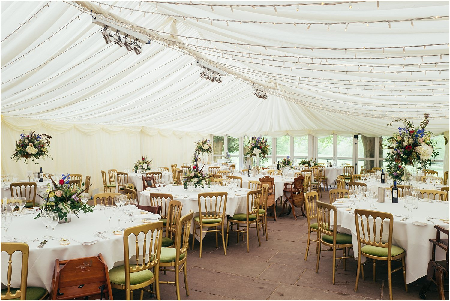 Interior of marquee for wedding at The Inn at Whitewell, Lancashire. Flowers by The Flower Shop of Clitheroe