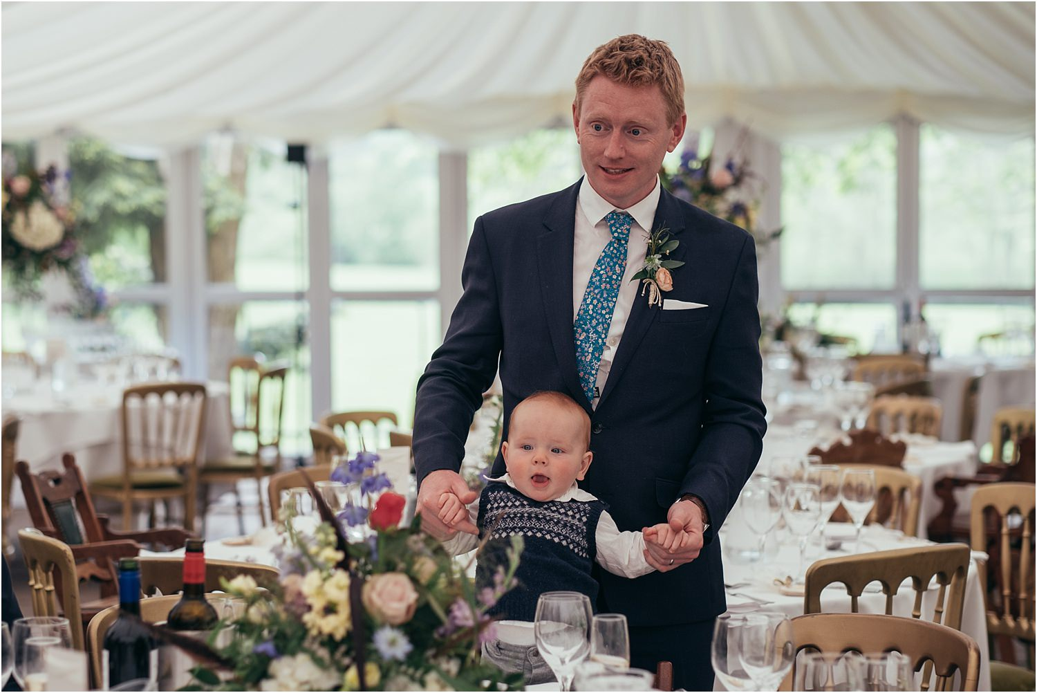 Best man and baby at Lancashire wedding reception marquee