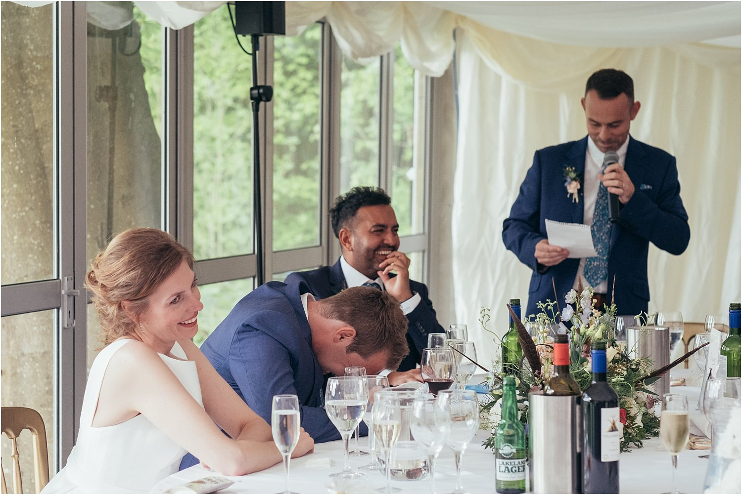 Groom's reaction to best mans's speech at Inn of Whitewell wedding