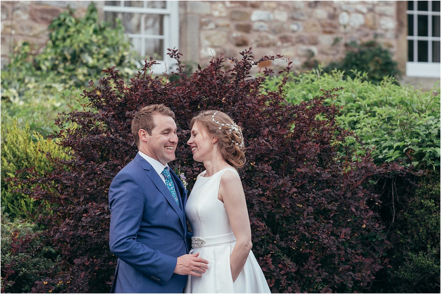Bride and groom in gardens at the Inn at Whitewell in the Trough of Bowland