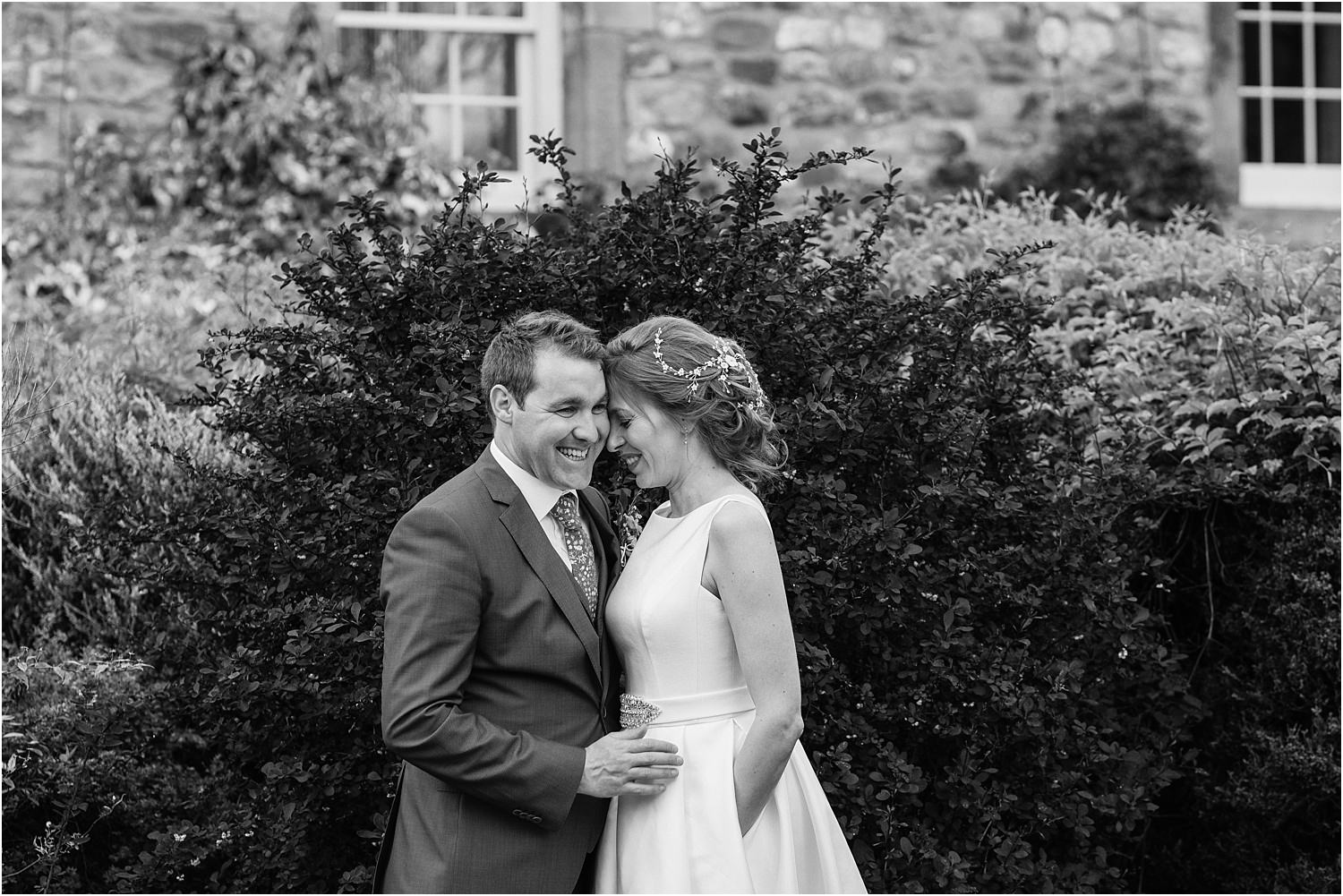 Bride and groom share an intimate moment after their wedding reception at the Inn at Whitewell in Lancashire