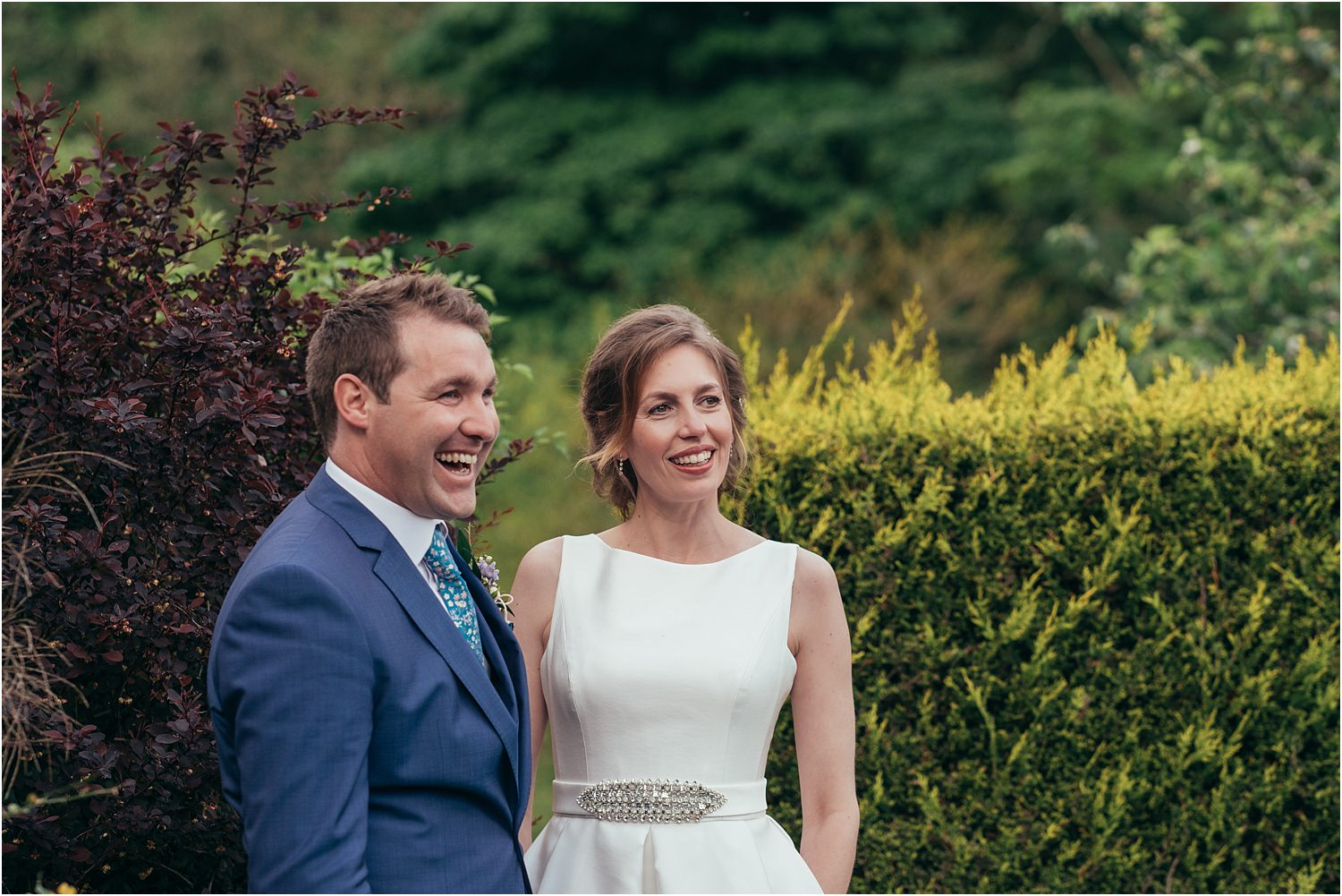 Bride and groom relax together afer their Lancashire wedding