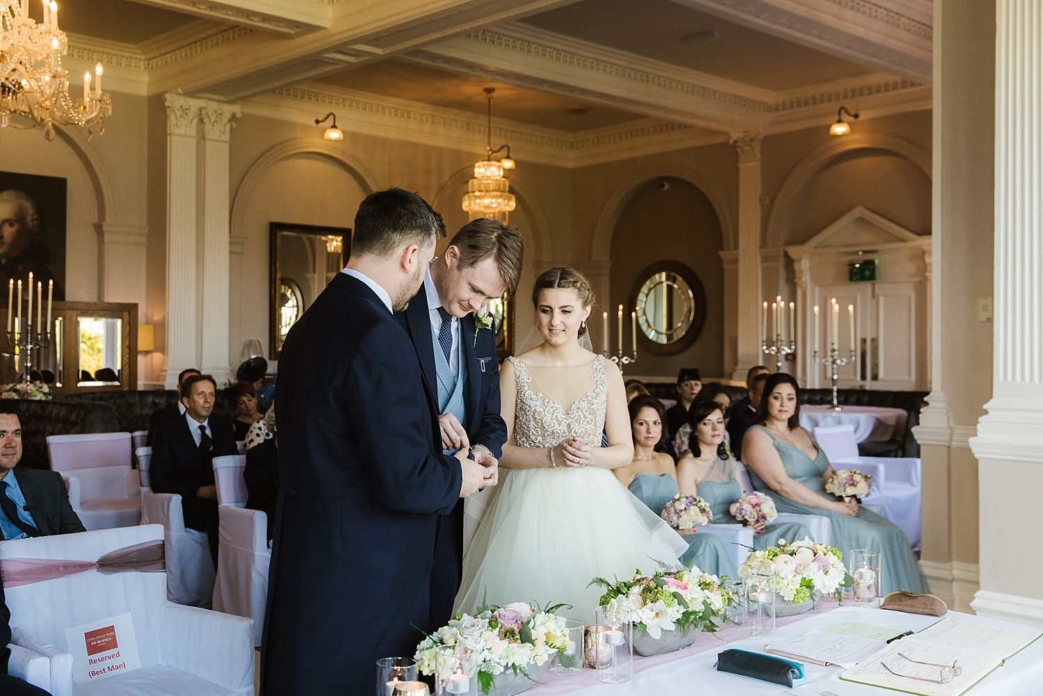 Best man hands over the rings at Belsfield Hotel wedding