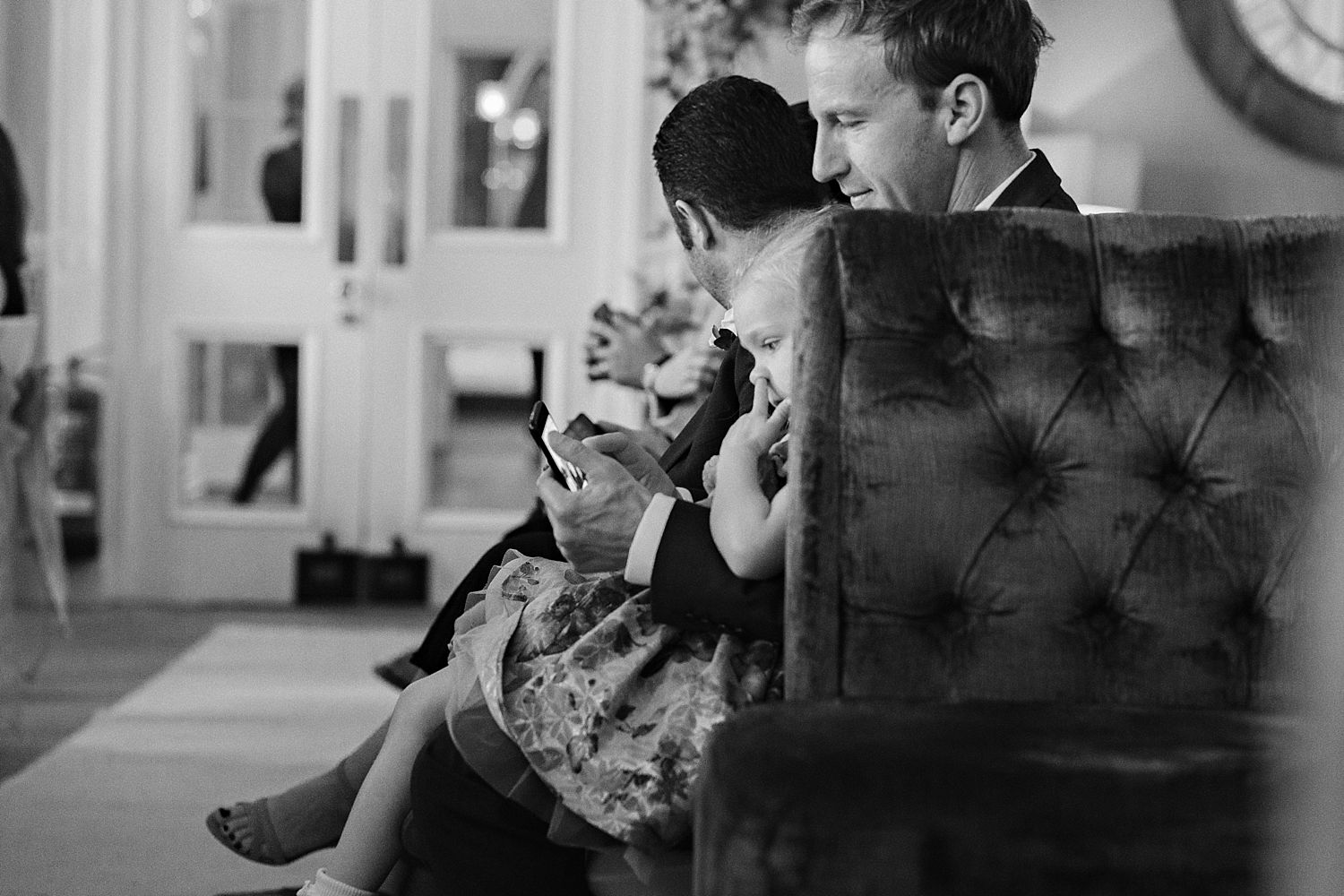 Small child wedding guest picking nose during ceremony at Lake District wedding