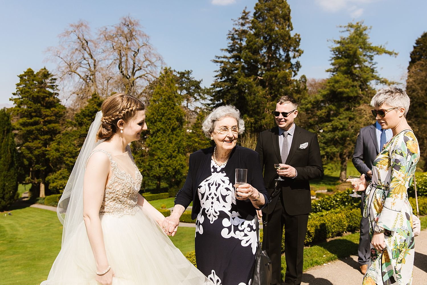 Bride greets guests at Lake District wedding venue, The Belsfield Hotel