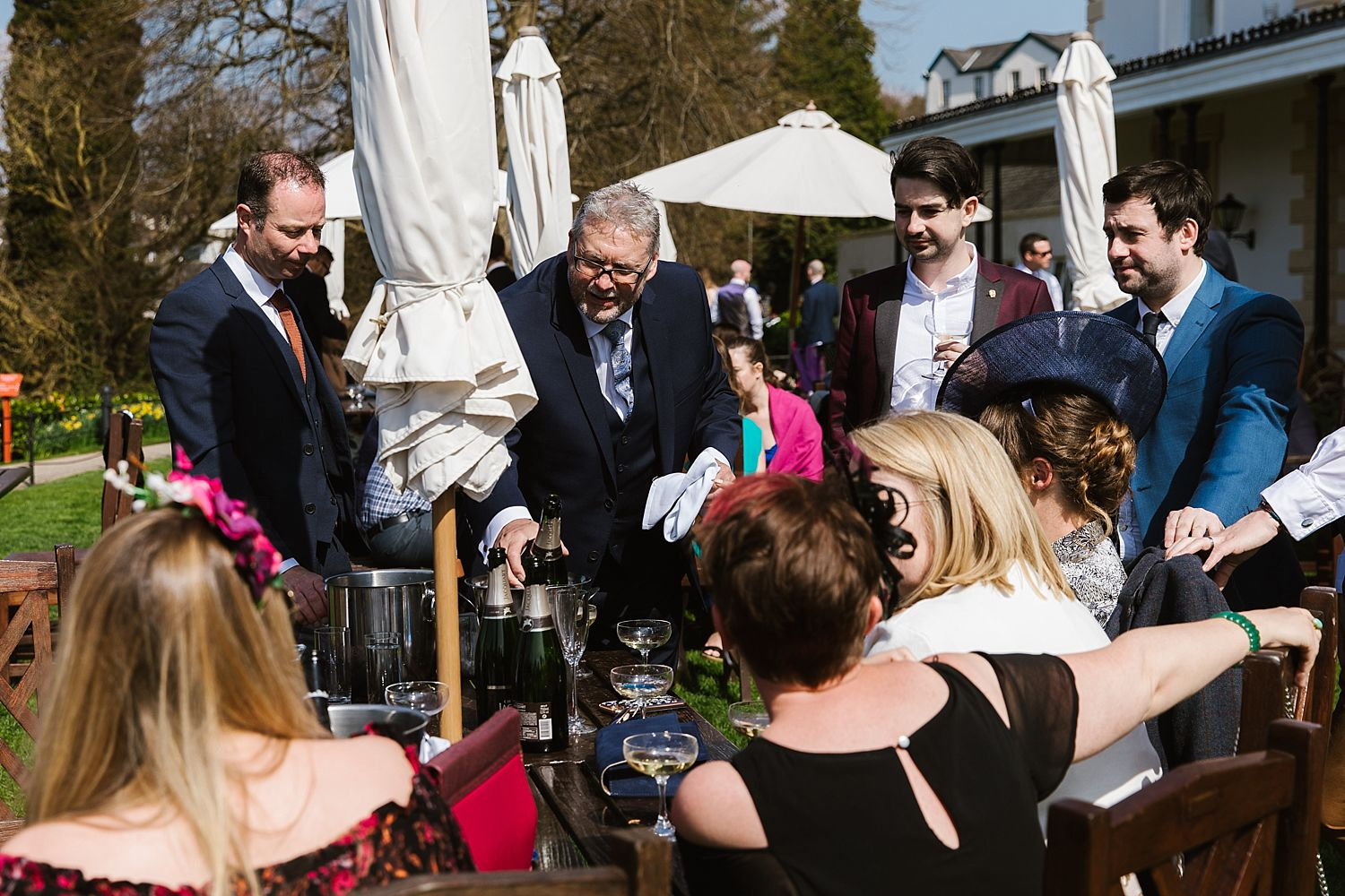 Guests sitting and enjoying champagne at Belsfield Hotel wedding