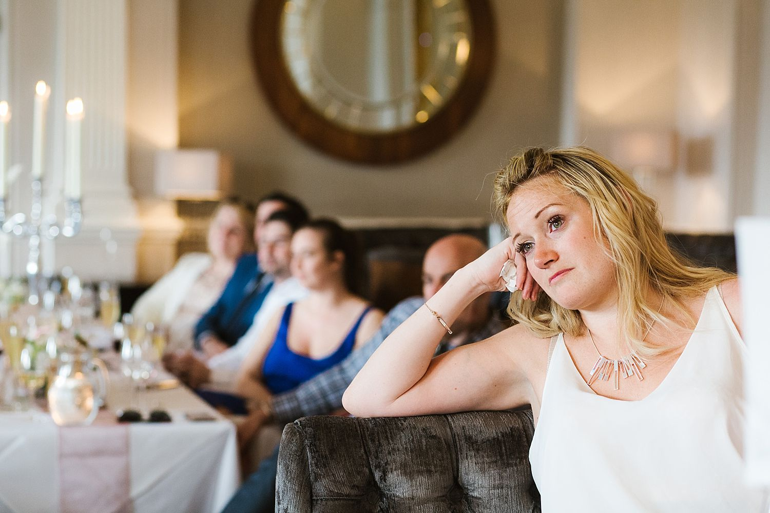 Lady with tissue, listens intently to speech at Lake District wedding